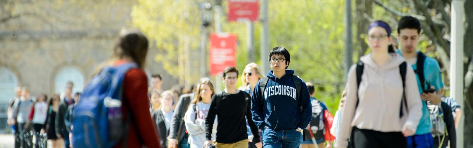 Students walk up Bascom hill.