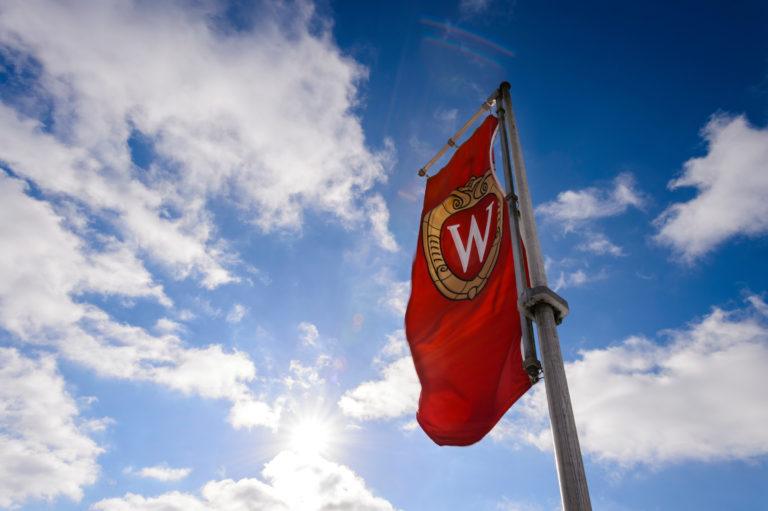 """A """"W"""" crest banner flies on Bascom Hill."""